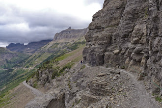 Photo: Gray skies at the start of our hike on the Highline Trail - Going to Sun Road below. For many people this is the scary part of the hike. That is why the park service provides a cable to hang onto during this stretch.