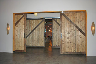 Photo: The sandwich core panel makes these large pocket doors lightweight and smooth.