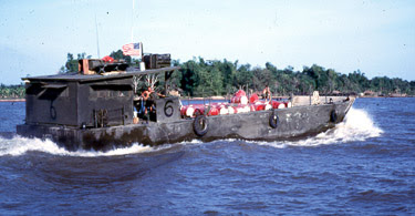 Photo: Another Units Mike Boat (tub) with gas barrels. Floating Bomb..  Beer was desired cargo.