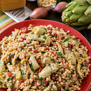 Israeli Couscous Salad with Artichokes and Roasted Red Peppers.