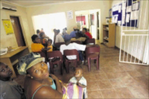 THE LONG WAIT: Zandspruit residents claims that the local clinic is small, stuffy and always full of patients who do not get much help.  20/01/2009. Pic. Antonio Muchave.  © Sowetan.
