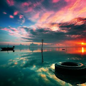 The Old Tyre and The sunrise by Razali Ahmad - Landscapes Sunsets & Sunrises