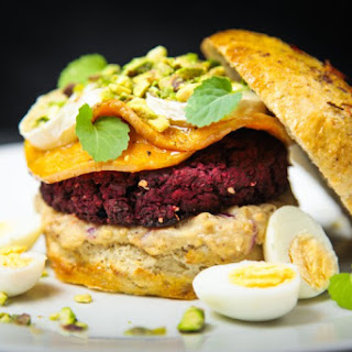 Beet Falafel Burger With Baba Ganoush, Cardamom Roasted Butternut Squash, Chèvre And Pistachios.