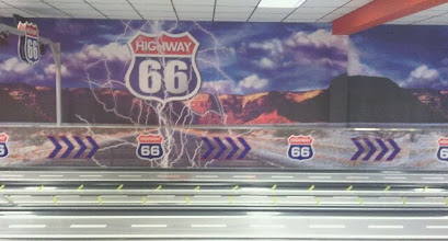 Photo: The artwork for the bowling alley wall at the rear of a Skegness Casino, using the Route66 theme of the adjacent Casino Cafe. Rather romanticised as the prehistoric fumarole stacks made famous in Close Encounters are pretty much only found in areas of Wyoming, far from R66.