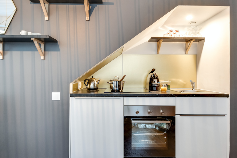 Fully equipped kitchen at Berthe Serviced Apartment, Montmartre