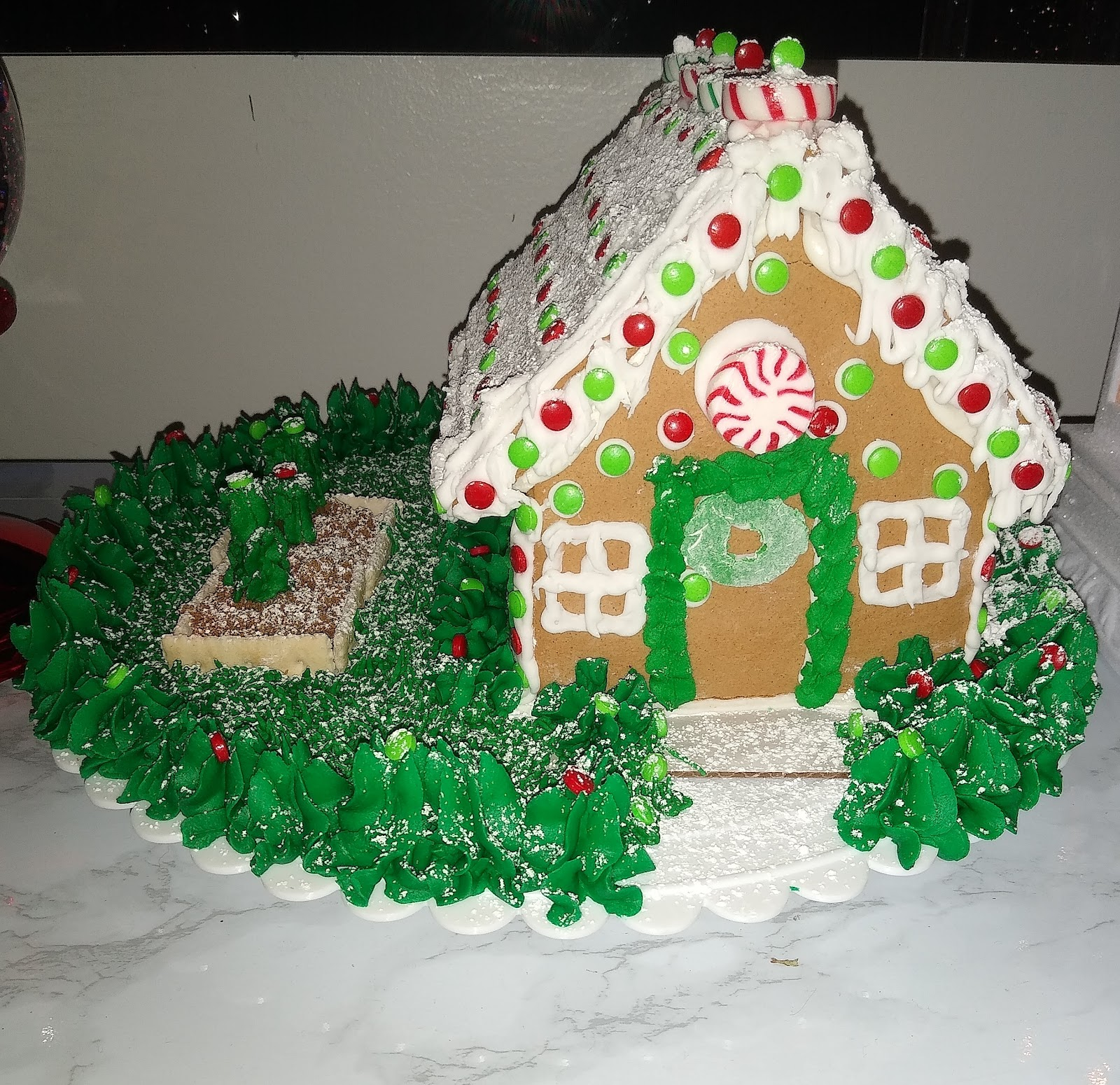 gingerbread house with a garden