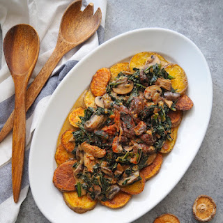 Kale and Mushroom Stroganoff over Crispy Roasted Potatoes.
