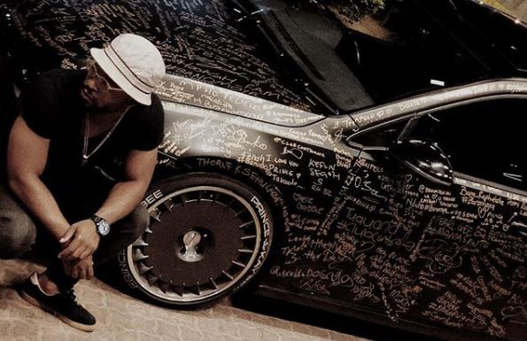 Prince Kaybee shows off all the signatures on his car.
