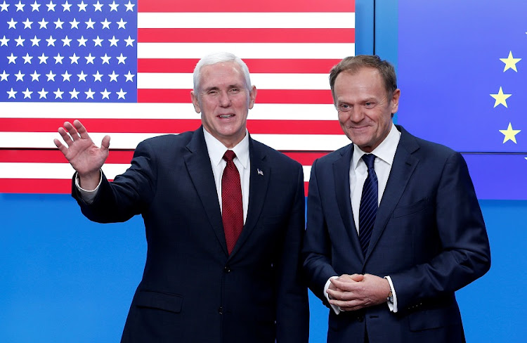 US Vice-President Mike Pence poses with European Council president Donald Tusk in Brussels, Belgium, on Monday. Picture: REUTERS/FRANCOIS LENOIR