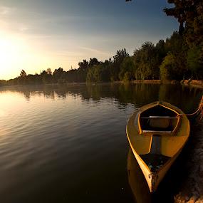 Boat a tsunrise by Cristobal Garciaferro Rubio - Transportation Boats ( water, reflection, lagoon, lake, sunrise, boat )