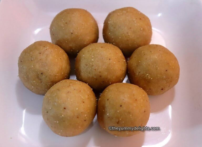 top view of peanut ladoos placed on a white plate.