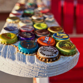 Bottle Caps by Svemir Brkic - Artistic Objects Other Objects ( bench, white, old, bottle cap, colorful )