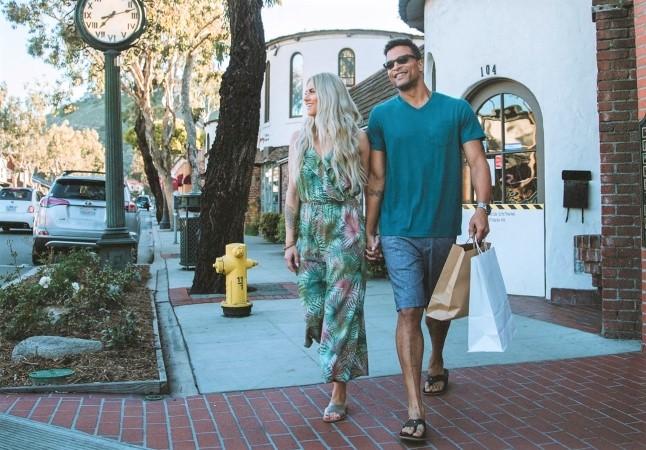 A couple walking in Laguna Beach