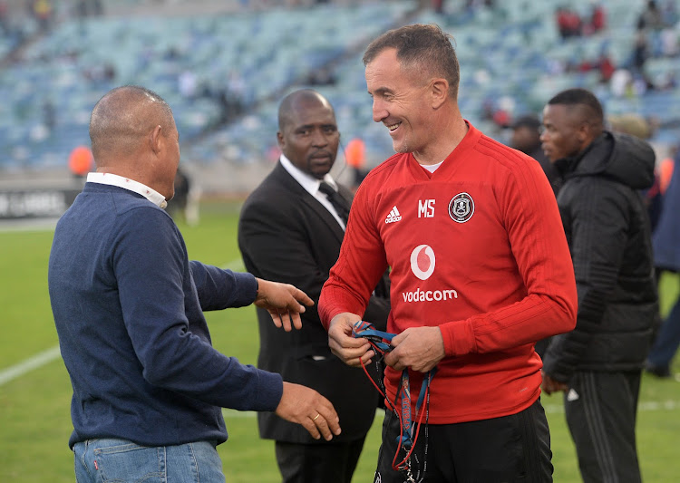 AmaZulu coach Cavin Johnson (L) chats to his Orlando Pirates' counterpart Milutin Sredojevic following a Telkom Knockout semifinal match at Durban's Moses Mabhida Stadium on November 3, 2018.