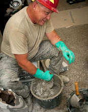 Photo: U.S. Air Force Master Sgt. Donald Maier, 219th RED HORSE Squadron, mixes a batch of skim coat wall material at an elementary school in Ogulin, Croatia, June 23, 2014. The school bathrooms are being renovated by Airmen from the 133rd and 148th Civil Engineering Squadron, and 219th RED HORSE Squadron in partnership with the Croatian army. Croatia is a Minnesota state partner under the National Guard State Partnership Program. (U.S. Air National Guard photo by Staff Sgt. Austen Adriaens/Released)