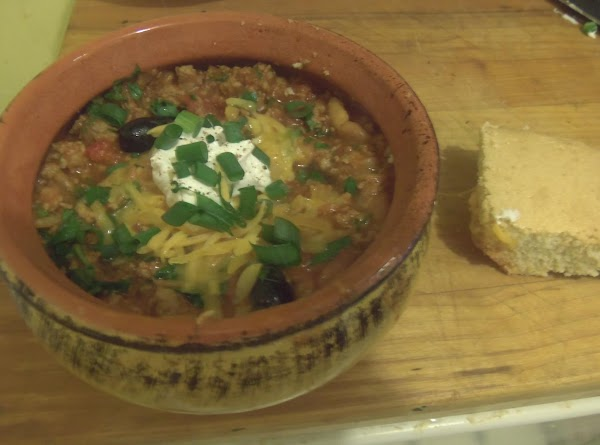 To serve, spoon the chili in a bowl, add parsley, cheese, sour cream and...