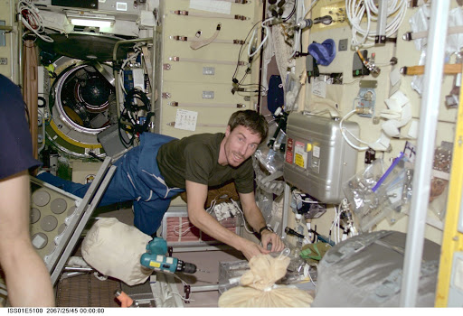 Krikalev in Service module with tools