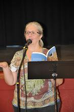 Photo: Former Redmond poet laureate Rebecca Meredith reads her poetry.