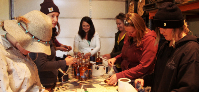 Karen Hoskin And Her Team Bottling Montanya Rum By Hand