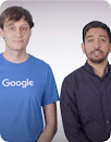 Two male Googlers featured in the video standing side by side.