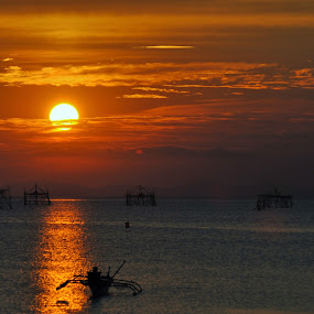 sunset at the bay by Greg Crisostomo - Landscapes Sunsets & Sunrises ( shore, bay, sunset, fishing, boat, , #GARYFONGDRAMATICLIGHT, #WTFBOBDAVIS )