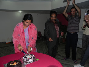 Photo: Dr. Mahapatra's wife also cuts the New Year cake