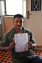 Photo: Nader, a Palestinian from the West Bank town of Bethlehem, holding a paper verifying that he served 7 years in Israeli administrative detention from 2001-2008. His story is not uncommon. Many Palestinian men his age who grew up during years of the second Intifada suffered a similar fate, receiving prison sentences of five years or more simply for throwing rocks.