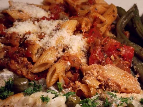 Pesto And Penne With Tomatoes And Artichoke Hearts