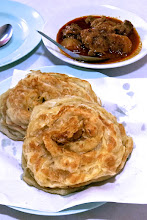 Photo: plain roti fried bread served with goat curry