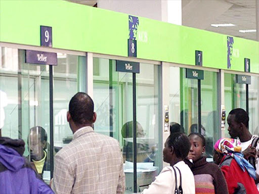 Customers queue inside a KCB branch in Nairobi. /FILE