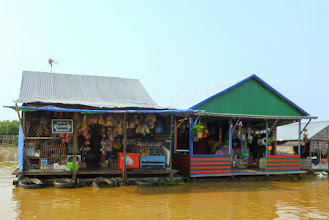 Photo: This is a community of floating houses and stores for the locals.  During the dry season these buldings are on the lake.