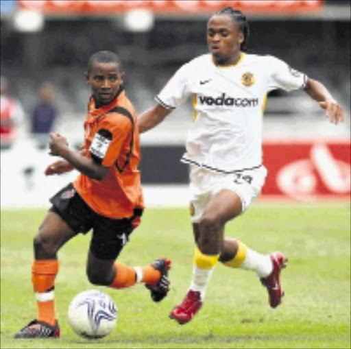 TRACKER: Thanda Royal Zulu's Edward Hadebe is chased by Kaizer Chief midfielder Siphiwe Tshabalala during thier Premiership match at Absa Stadium in Durban yesterday Chiefs won 2-1.  18/01/2009. Pic. Anesh Debiky.  ©  Gallo Images.