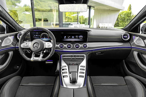 The interior takes many elements of the GT two-door but the centre tunnel features revised buttons. Picture: DAIMLER