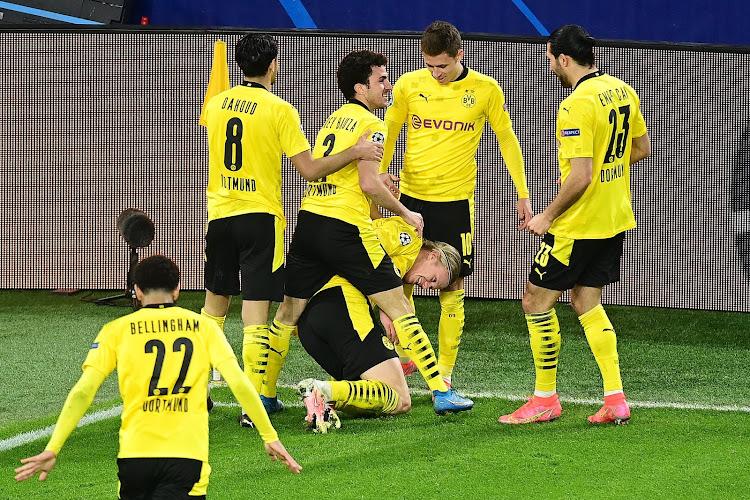 Hilarische beelden! Dortmundspelers overgieten trainer met bier na winst Duitse beker