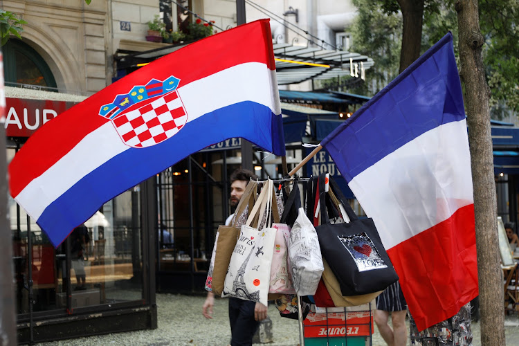 A Croatian flag and a French flag on sale at a kiosk in Paris prior to the 2018 World Cup final between France and Croatia.