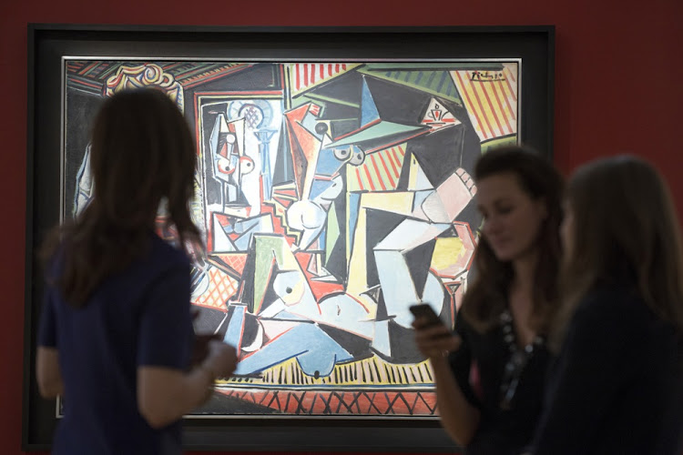 People view Pablo Picasso's Les Femmes d'Alger, Version 'O', at an earlier auction. On May 18, Marina Picasso is putting an additional 111 of her grandfather's artworks up for auction at  Sotheby's in New York, in a sale that is expected to yield $3.3m-$4.7m. Picture: REUTERS