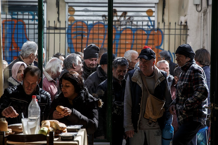 People line up outside a soup kitchen in Athens, Greece, last week. Picture: REUTERS/ALKIS KONSTANTINIDIS