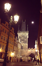 "Photo: Charles bridge at night, from the west side of the bridge. 11pm and there's still tourists milling about.  Note how noisy this picture is in comparison to the next picture (zoom in on the roof for example).  This was taken with my ""stock"" 18-55mm lens."