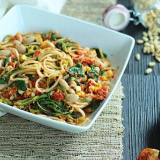 Sundried Tomato Pesto Zucchini Pasta with Corn, Beans and Spinach.