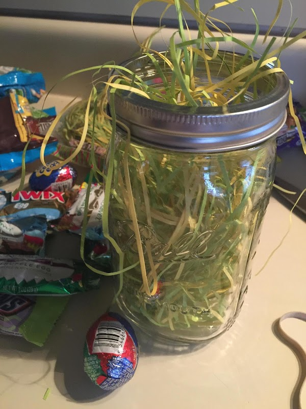 Place small amount of basket grass in bottom of jar, add mixture of different...