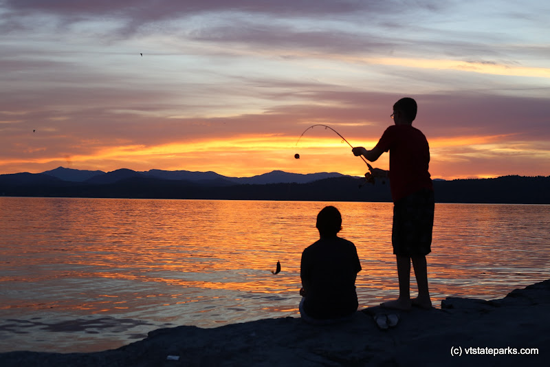 Photo: Boys fishing during a beautiful sunset at Button Bay State Park by Amanda Vincent