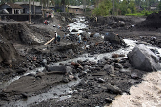 Photo: After the erupion: Lahars (mudflows from the volcanos) cut through villages