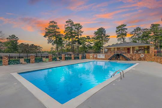 Rivers Edge apartment swimming pool at dusk