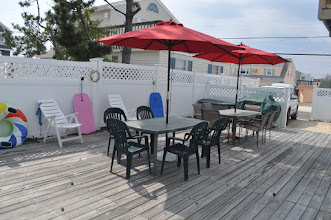 Photo: rear yard and deck opposite view