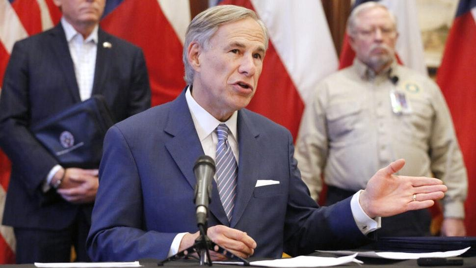 AUSTIN, TX - MARCH 29: Texas Governor Greg Abbott announced the US Army Corps of Engineers and the state are putting up a 250-bed field hospital at the Kay Bailey Hutchison Convention Center in downtown Dallas during a press conference at the Texas State Capitol in Austin, Sunday, March 29, 2020. The space can expand to nearly 1,400 beds. Joining him was former State Representative Dr. John Zerwas (left) and Texas Department of State Health Services Commissioner John Hellerstedt, MD.