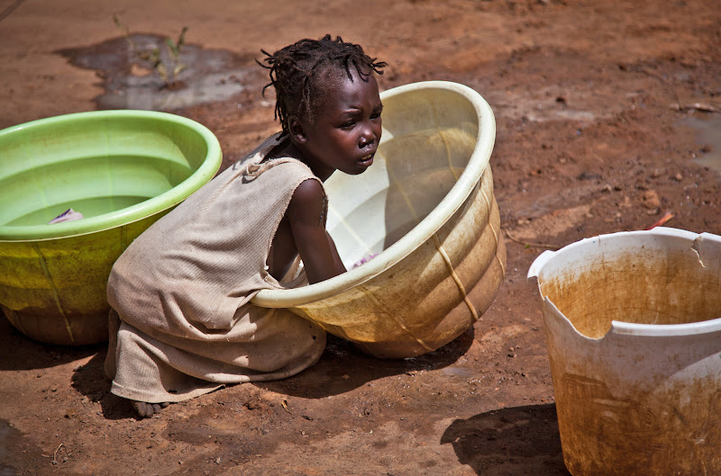 Photo: A young girl does her laundry at the Yida refugee camp in Yida, South Sudan. Thousands of people from the Nuba Mountains in South Kordofan, Sudan have fled to Yida to escape recent fighting and airstrikes by Sudan's Armed Forces (SAF).