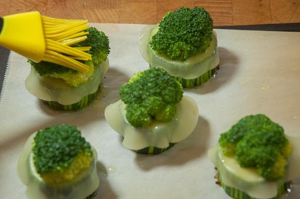 Brush some butter on top of the broccoli.
