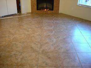Photo: Floor decor 18x18 Pompei Mocca tile installation on floor & fire place surround