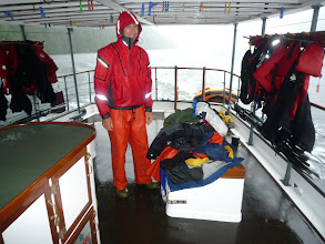 Photo: The best part of a rainy day is coming back onboard!  Luke takes all our wet gear to the warm engine room, where it dries in no time.