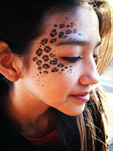Photo: Leopard print face paint design by Tess, Orange, Ca. Call to Book Tess at 888-750-7024
